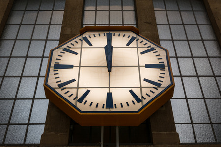 Large Stone Wall Clock Windows Glass Train Station Hands Midday 12 o Clock Glowing Face Hands
