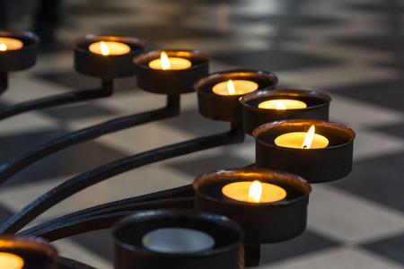 Church Prayer Candles Metal Frame Closeup Perspective Texture Religious Light Burning Yellow Flame