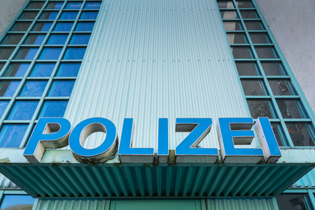 precinct station: Polizei Police Sign Station Front Entrance Authority Blue Shield Title Large Letters Doors Closeup