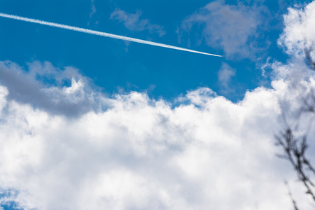 White Clouds Blue Sky Fluffy Sun Flare Airplane Trail  Sunny Daytime Texture Background