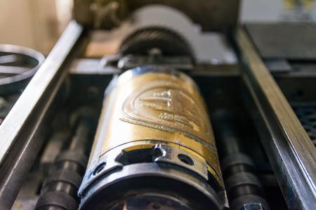 Golden Letterpress Cylinders Rustic Vintage Printing Method Metallic Rollers Four Color CMYK Print Closeup Machine Industrial Equipment Stock Photo