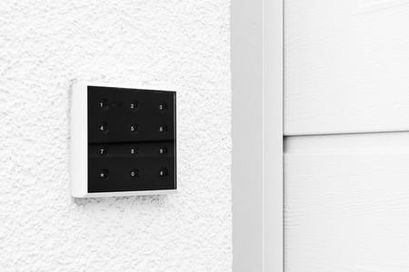 Black and White Modern Contemporary Keypad Design Garage Door Stock Photo