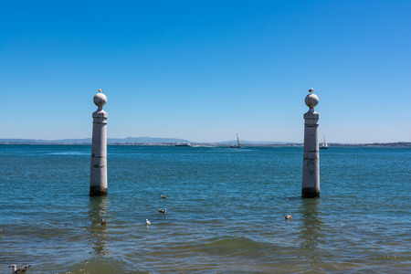 View of Ocean from Shore of Comercio Square in Lisbon Portugal Stock Photo
