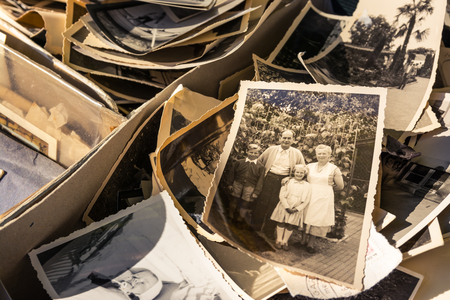 Old Box of Photos Edges Worn Collection Vintage History Family Nostalgia 에디토리얼