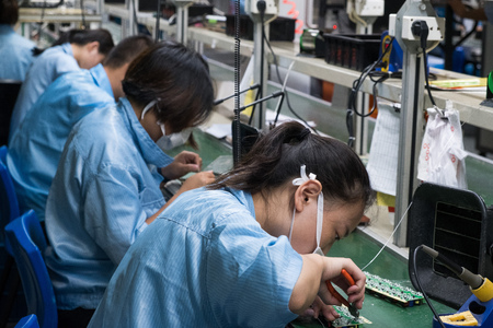 Asian Chinese Electronics Factory Workers Female Industry Manufacturing Assembly Line Archivio Fotografico - 118464464