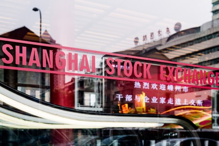 SHANGHAI, CHINA - January 2018: Shanghai stock exchange sign on glass window in Chinas most developed city 新聞圖片