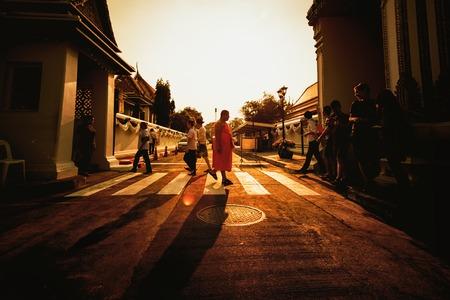 Bangkok, Thailand - February 2 ,2019: Monk Walking Alone at Sunset Crosswalk City Thailand Asian Urban Scene Religious Disciple in Crowd