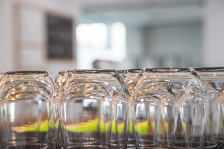Empty Upside Down Glasses in a Quiet Calm Cafe Warm Light Gastronomy Equipment Stok Fotoğraf
