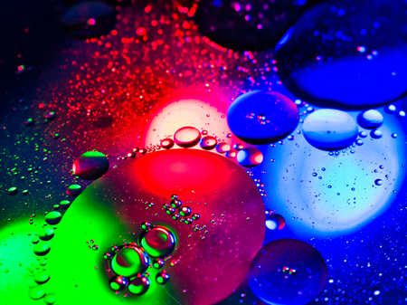 Multcolored RGB Red Green Blue Lights through Oil Bubbles Abstract Liquid Detail