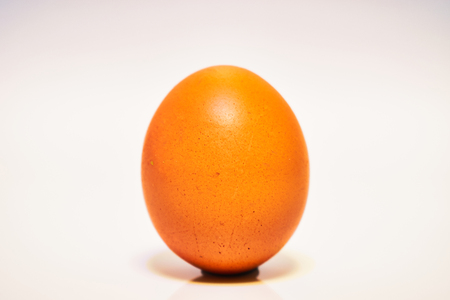 Orange Dark Color Chicken Egg Isolated on White Background Stok Fotoğraf