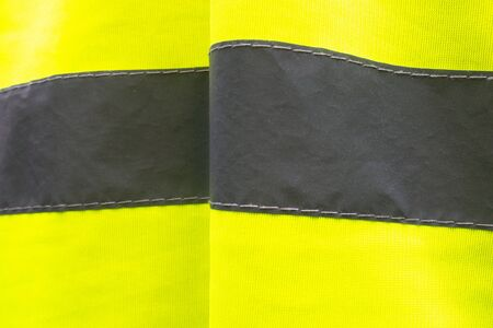 Closeup of Yellow High Visibility Neon Vest Stripe