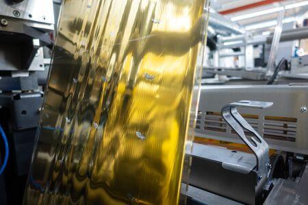 Industrial Label Printing Equipment Closeup DetailMetallic Foil Embossing Web
