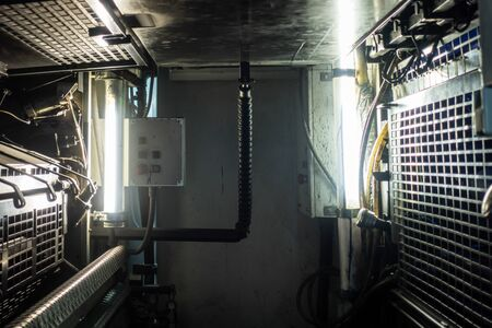 Industrial Machine Inside Underneath Various Metal Details Fluorescent Lights Grids Equipment Stok Fotoğraf