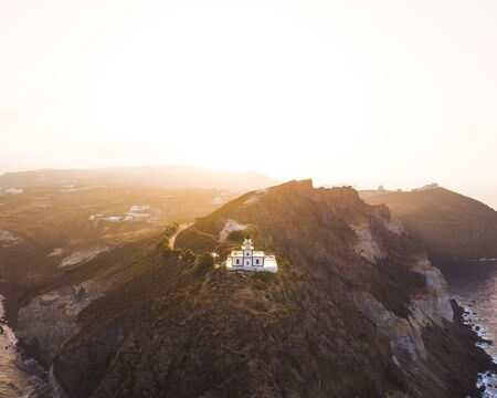 Santorini Lighthouse Aerial Shot Sunrise Dramatic Travel Landscape