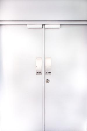 flush: two flush doors with metallic push sign and door knob