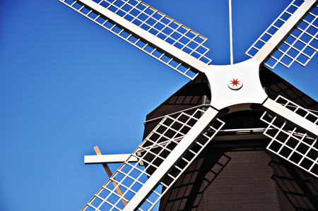 Closeup Windmill house on blue sky background