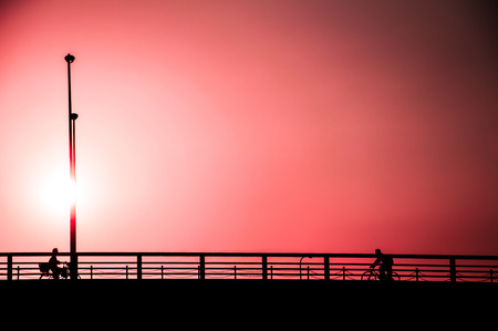 Minimalist style of people under color filter effect sky background at sunset