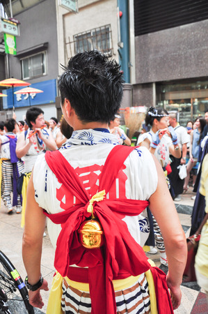 Osaka, Japan - July 25, 2012: An unidentified young man dress in the festival clothes, participating in Tenjin Matsuri Osaka's biggest festival.