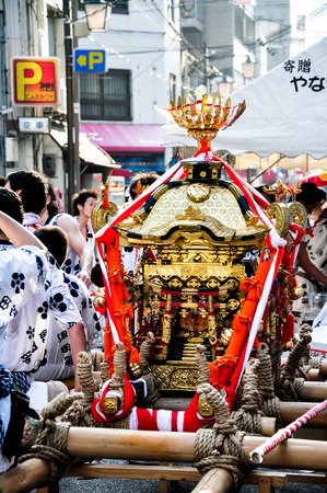 worshiped: Osaka - July 25, 2012: A Portable golden shrine worshiped in Tenjin Matsuri, the biggest festival in Osaka