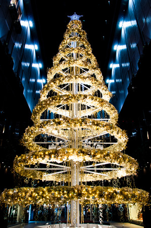gold tree: Decorated gold and yellow Christmas tree for celerating season