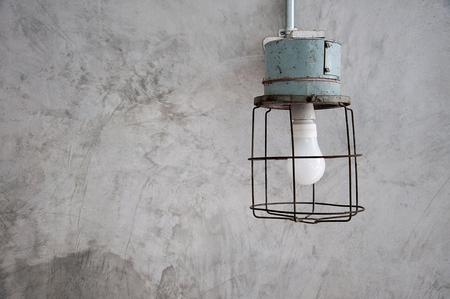 Antique minimal lamp on concrete wall