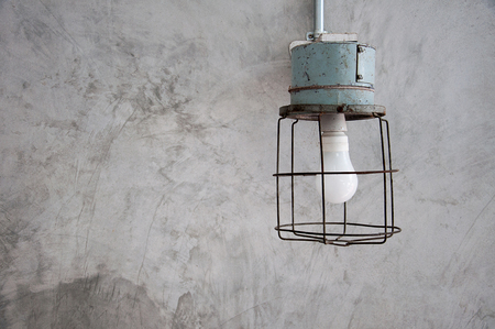Antique minimal lamp on concrete wall