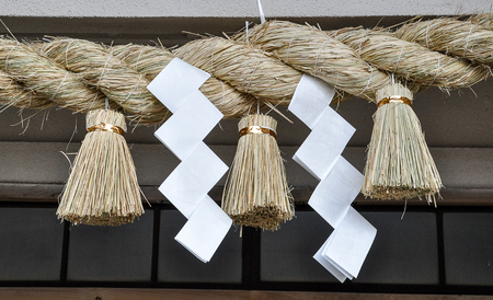 Sacred rice straw rope in Shinto shrine and temple