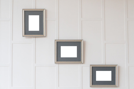 Empty frames on white wall