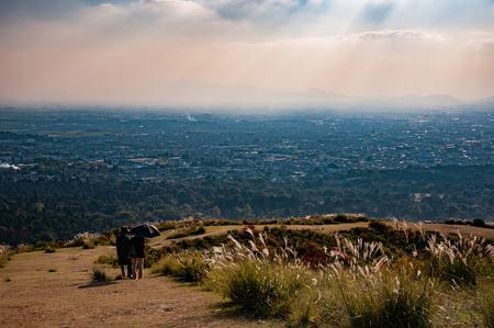 Unidentified women enjoying the view of Nara city from the top of Mount Wakakusayama, Nara, Japan