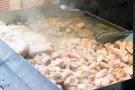 Steaming grilled pork on teppanyaki pan