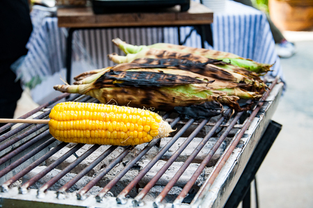 Grilled corn on grill pan Stock Photo