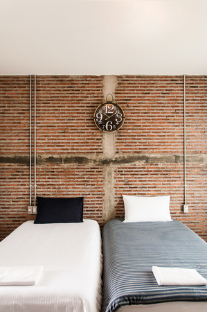 Beautiful loft style bedroom with brick wall