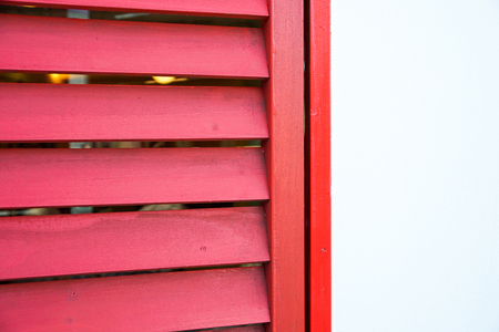 Red vintage window on white wall building
