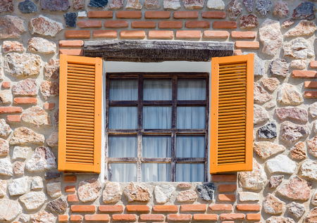 Opening windows from the house made from rocks