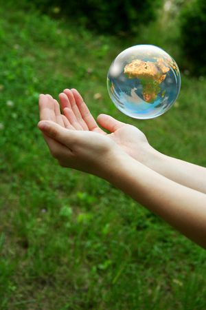 save environment: A globe above the women hand.