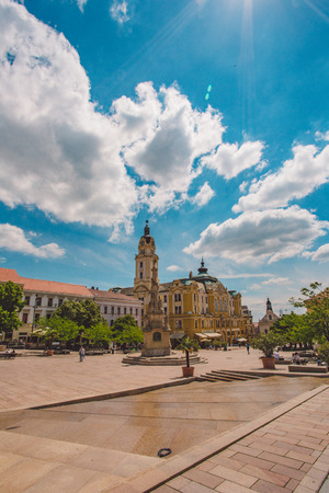 PECS, HUNGARY - MAY 2019: View of people as they pass by on the pedestrian zone in downtown May 2019 in Pecs, Hungary