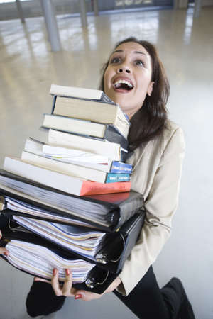 Business woman balancing the files while falling.