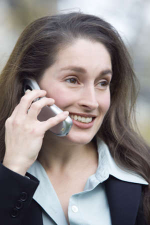 blissfulness: Close up of a smiling business woman talking on the phone.
