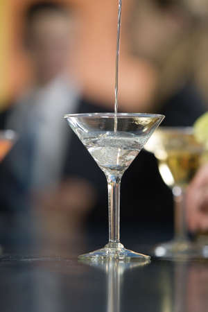 Close up of a glass being filled with a cocktail. Stock Photo - 3083899