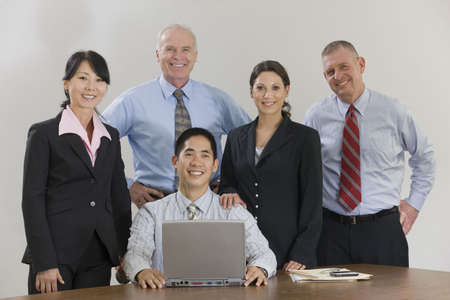 Business team portrait.  Five diverse team members looking at the camera while smiling about their success. Stock Photo - 5543204