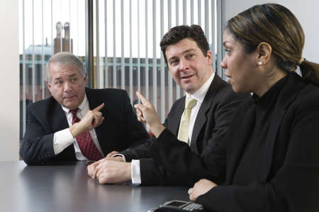 View of business people arguing in a boardroom. Stock Photo