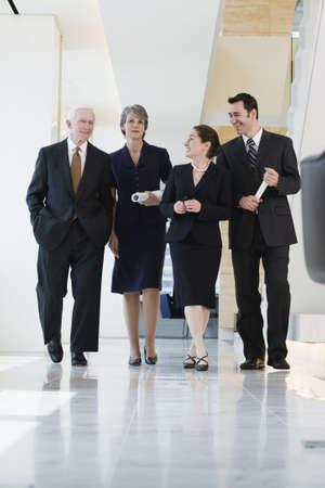 power walking: View of businesspeople walking in a corridor.