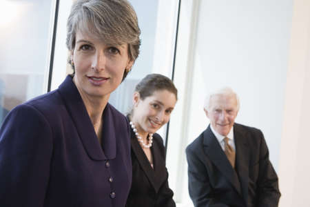 Portrait of businesspeople smiling in an office. Stock Photo - 5579463