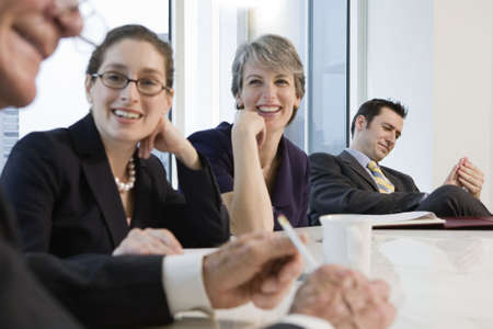 View of businesspeople smiling in an office meeting. Stock Photo - 5579456