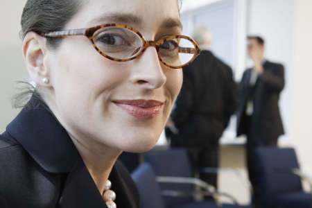 Portrait of a businesswoman smiling in an office. LANG_EVOIMAGES