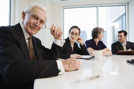 Portrait of businesspeople smiling in an office. Stock Photo - 5579470