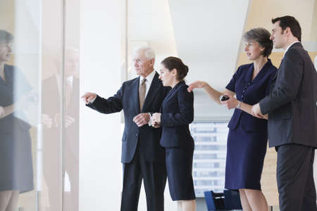 View of businesspeople discussing in an office. Stock Photo - 5579468