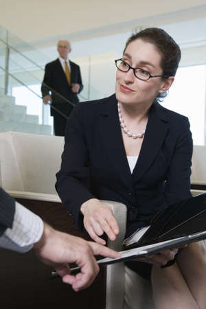 office: View of businesswoman sitting in an office.