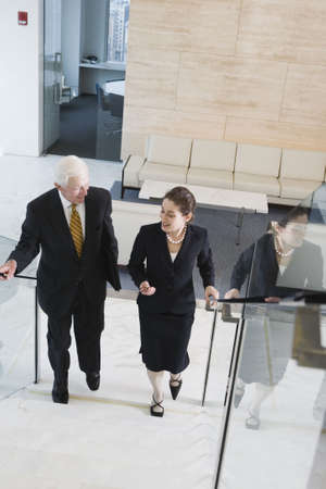 Elevated view of businesspeople walking on a staircase in an office. Stock Photo - 5579472