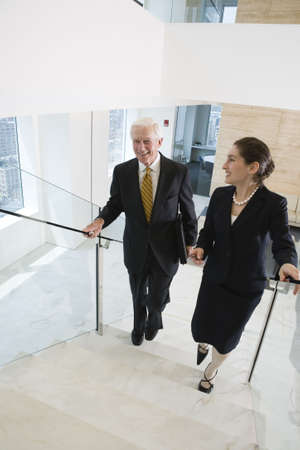 Elevated view of businesspeople walking on a staircase in an office. Stock Photo - 5579466